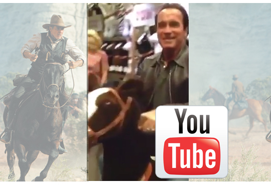 Arnold Schwarzenegger on a toy horse